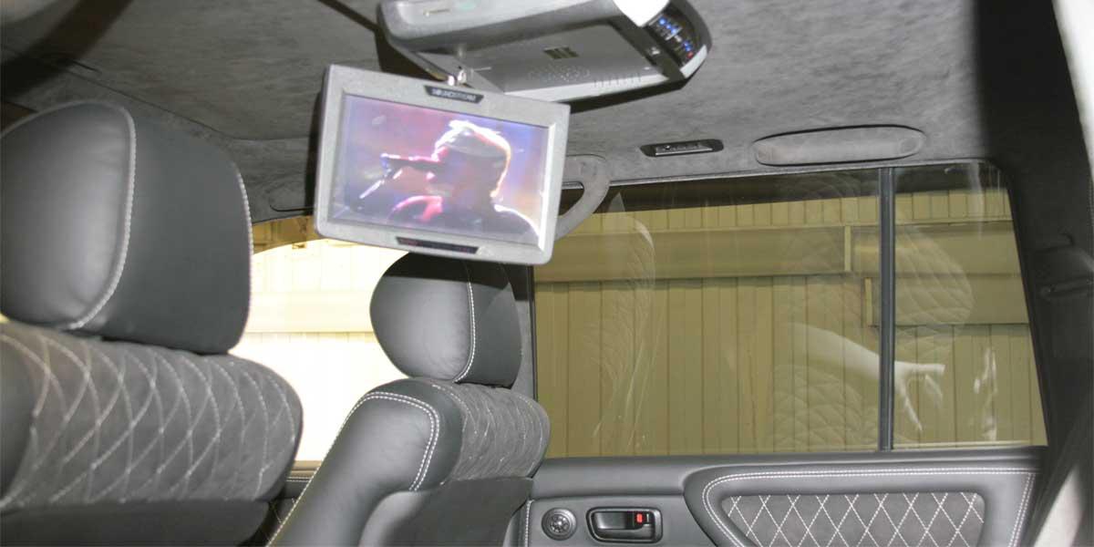 Перетяжка салона и доработка штатной мультимедиа системы Toyota Land Cruiser 100
